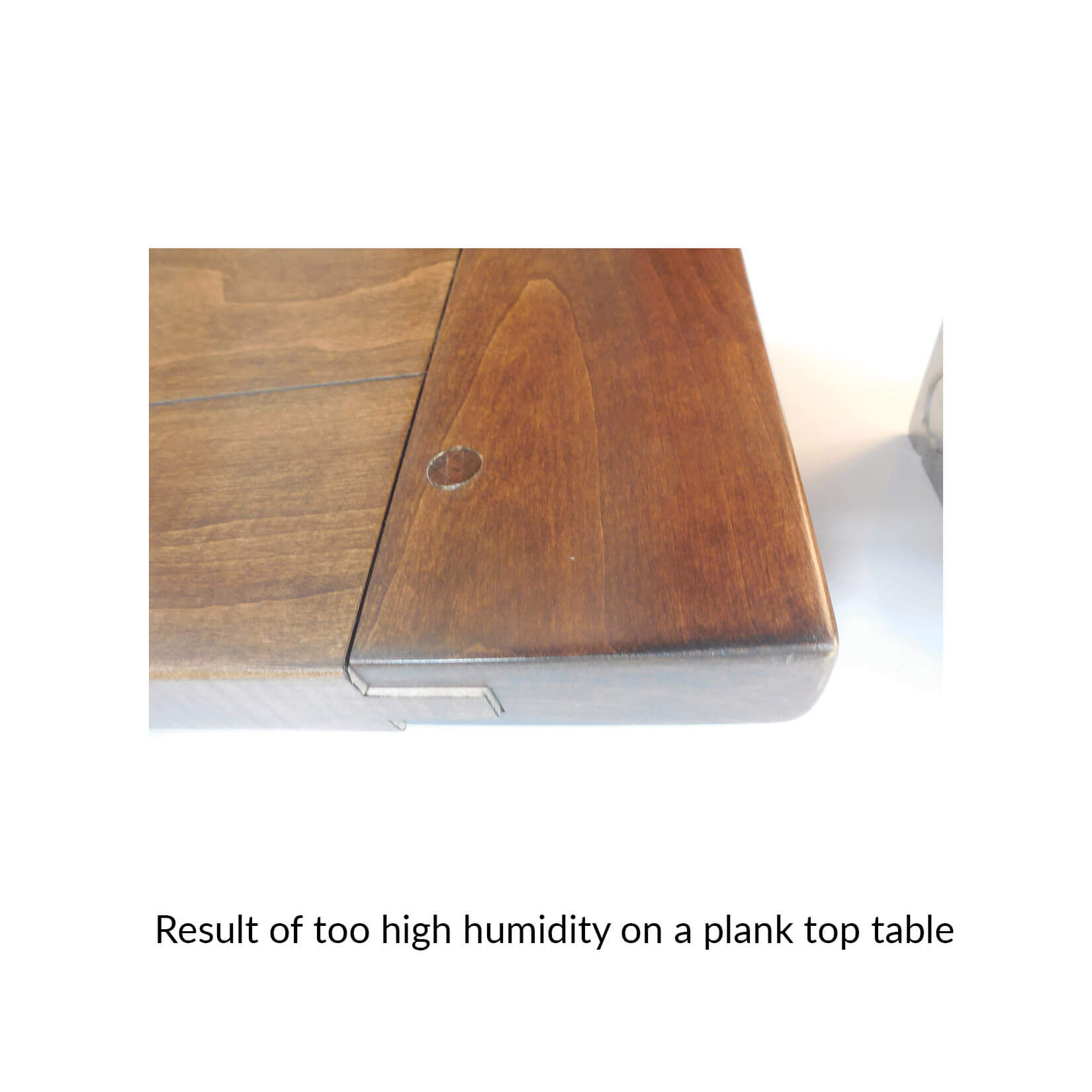 1.-result-of-too-high-humidity-on-a-plank-top-table.jpg